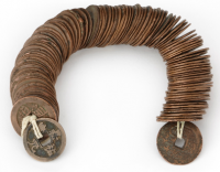 String of 100 Chinese cash coins, Qing dynasty, copper-alloy, 500 g., Ashmolean Museum, Oxford